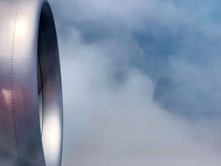 The turbine of the airplane above the clouds closeup, view from the porthole