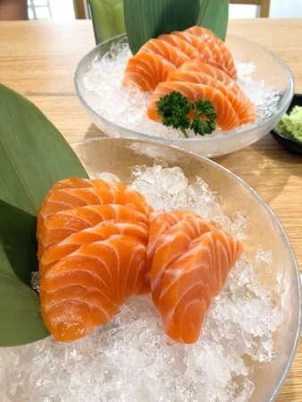 Fresh orange sliced salmon or Salmon Sashimi on ice in the glass bowl Stok Fotoğraf