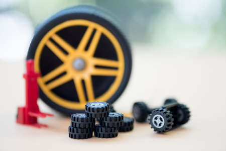 Miniature vehicle toy spare parts and Vehicle tire repair equipment.  Seasonal tire change