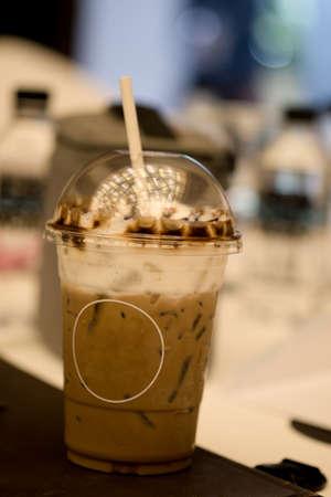 Glass of iced coffee mocha with milk foam 스톡 콘텐츠