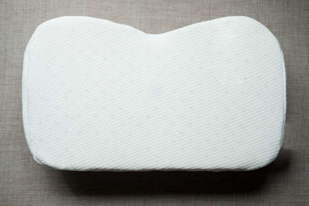 White orthopedic pillow. Physiotherapy concept
