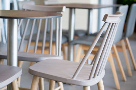 Set of table and chairs in cafe, close up