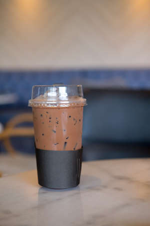Iced coffee mocha in takeaway cup at coffee shop 스톡 콘텐츠