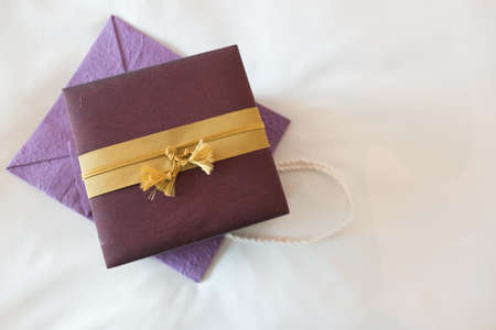 Silk gift box on purple mulberry paper bag