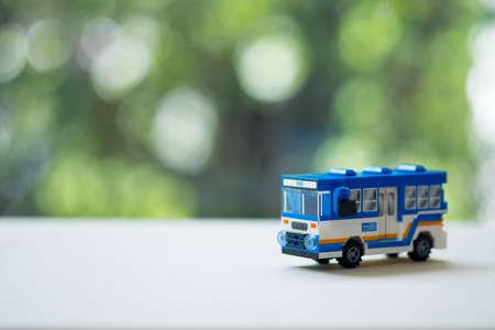 Miniature Thai bus on wood table