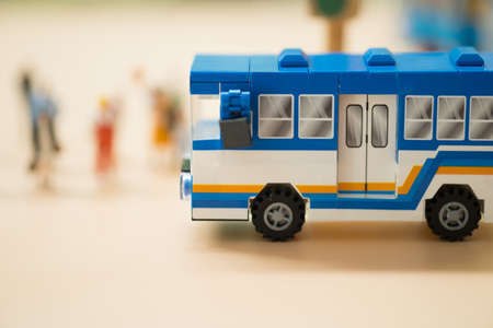 Miniature toy bus. People travel by bus in Bangkok. Buses are one of the most important public transport system in Bangkok.