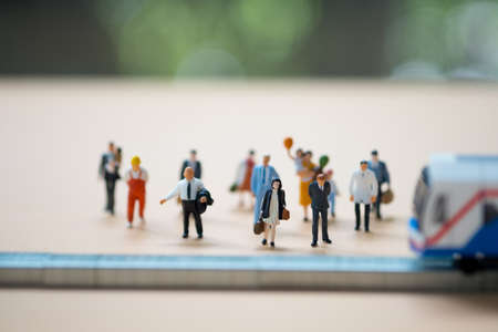 Close up miniature people waiting train at early morning rush hours, busy modern life concept. Thailand public transportation concept Stockfoto