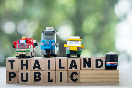Miniature toy put on wooden blocks. Concept of convenient methods to travel around Bangkok.