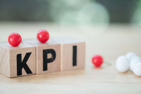 Letter block in word KPI (Abbreviation of key performance indicator). Metric or measurement to achieve or success in business or success in work.