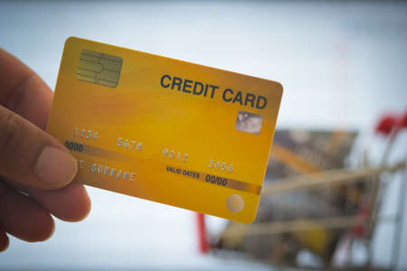 Close up man man holding mock up credit card.Online shopping concept.