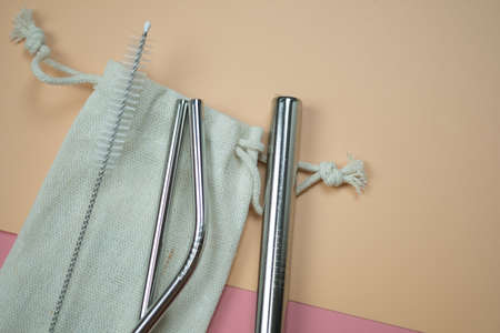 Metal tubes for cocktails with schutkoy for cleaning and small linen fabric bag. Zero waste concept