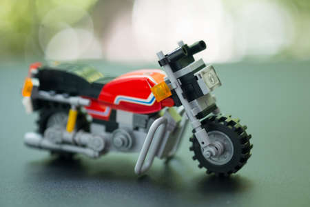Lovely red motorcycle toy plastic toy for children the realistic motocross bike studded tires Banco de Imagens