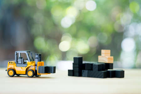 A forklift truck carries a black wood puzzle to the unfinished assembly of business team. Concept of creating an efficient and productive business unit. Leadership and teamwork Stok Fotoğraf