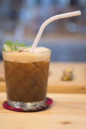 Espresso, mint and lime cocktail in a glass. Coffee cold brew concept.