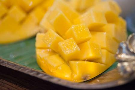 Close up of heap yellow mango. Popular traditional dessert of Thailand.