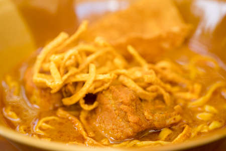 Curried noodle soup with braised pork Thailand call Khao Soi. Khao soi Traditional Thai Food