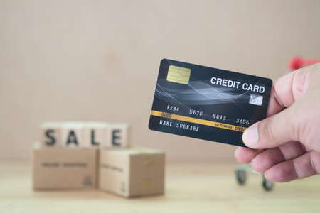 Hands holding credit card using for online shopping. Payments credit card online shopping.