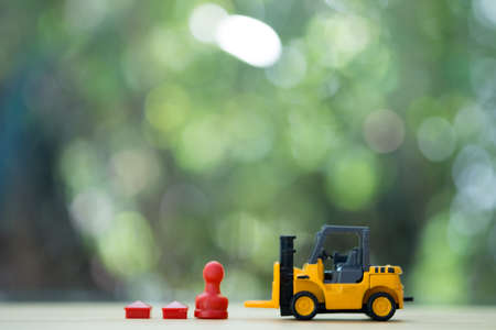Face to face miniature forklift and Thai-chess with home. Concept of for Strategy to success.