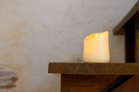 Light candle put on wooden staircase decoration in home Stock fotó