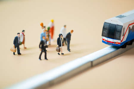 Close up miniature people waiting train at early morning rush hours, busy modern life concept. Thailand public transportation concept 写真素材