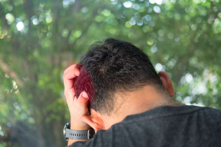 Young man are stressed and hand holding head with headache. Stress and frustration concept.
