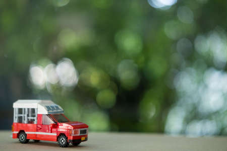 Miniature toy of red mini Truck Taxi at Chiang Mai Thailand. Service inside Chiang Mai City.