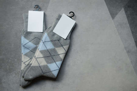 New two soft knitted sock on stone background. Concept of winter clothes Banco de Imagens