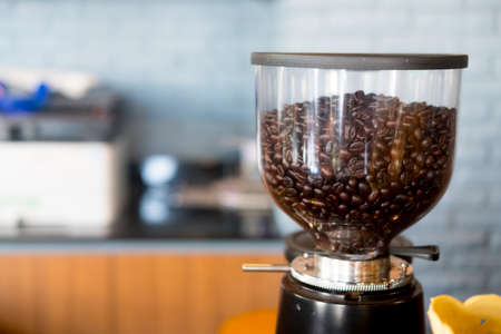 Automatic professional coffee maker and coffee grinder in a cafe. Coffee beans