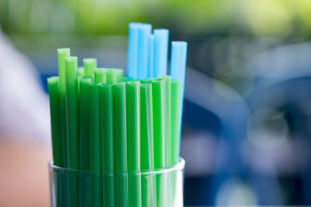 Drinking straws for party against on blur background