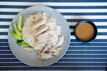 Rice steamed with chicken soup with cucumber (hainanese chicken rice) Stock Photo