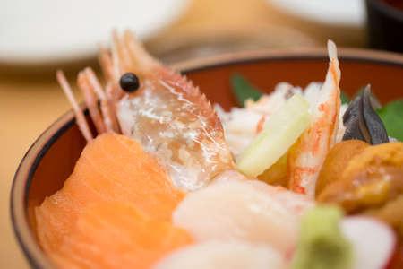 Fresh raw seafood mixed rice bowl (Kaisen-don, Japanese tasty food).