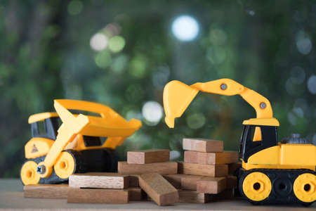 Diorama construction with yellow construction machinery models. Childrens toys of construction machinery Stock Photo