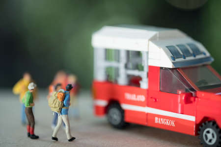 Miniature passenger travel by red mini truck taxi at Bangkok Thailand