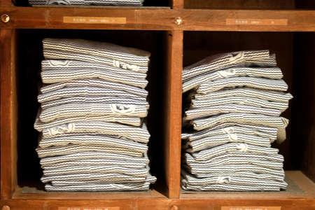 Stock of yukata on wood shelf in hotel