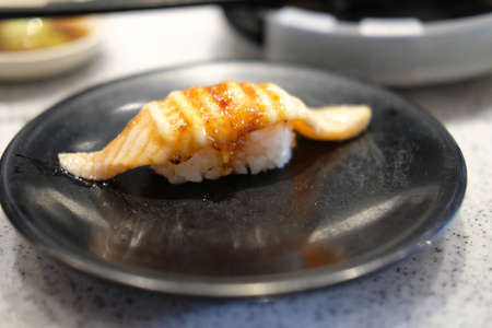 Burning salmon fish Sushi. Japanese food