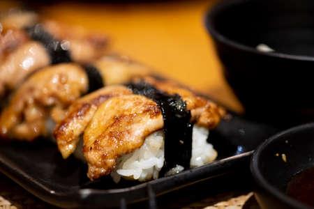 Foie gras sushi on black dish, close up Zdjęcie Seryjne