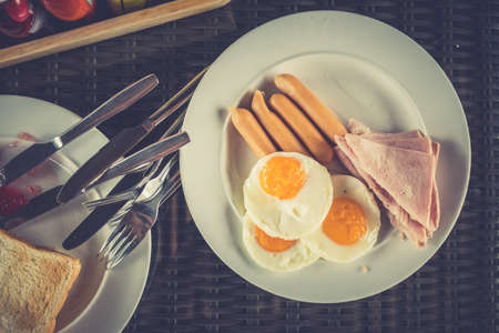 Typical breakfast with eggs, bacon and sausage on plate