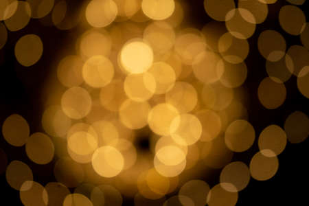 Orange bokeh lights background for design