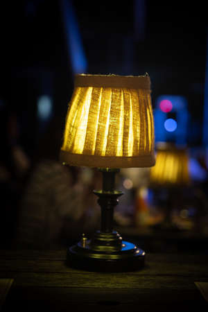 Warm lamp on table in restaurant at night
