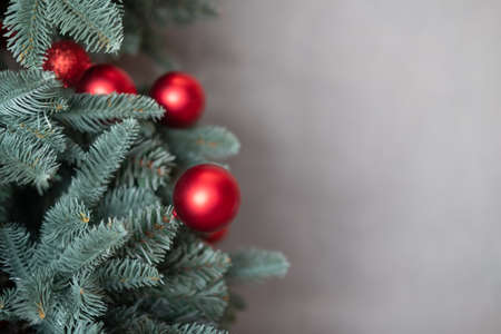 Red ball hanging from Christmas tree.  Close up Banco de Imagens