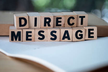 Direct Message word written on wood block. Private and premium direct message for your