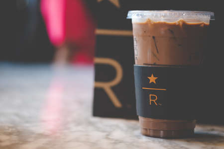 Bangkok, Thailand - Feb 2, 2020: Starbucks cold mocha drink in plastic cup in Starbucks Reserve bar. Famous coffee brand franchise originated in USA Imagens