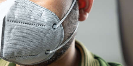 Man wearing facial Filter face mask for protect pollution, anti smog and viruses. Environmental pollution concept. 스톡 콘텐츠