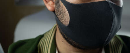 Man wearing black face mask protect filter against air pollution or protect virus