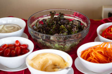 Variety of fresh vegetables and dressing salad. catering and guest service at the event.
