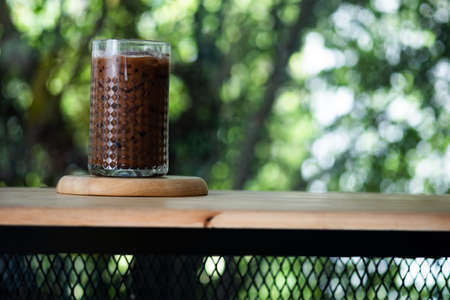 Glass of iced cocoa on wood table drink for relax