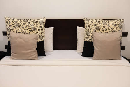 White bed sheets and pillows in hotel