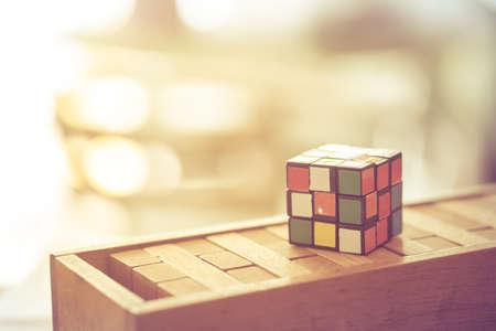 Generic puzzle cube put on wood block puzzle