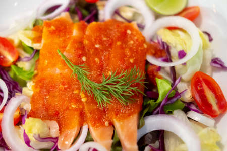 Salmon sashimi with spicy hot sauce. Japan salmon sashimi and Thai herb in Japanese restaurant. Imagens