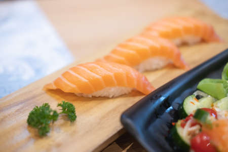 Close up of sushi with salmon. Selective focus.